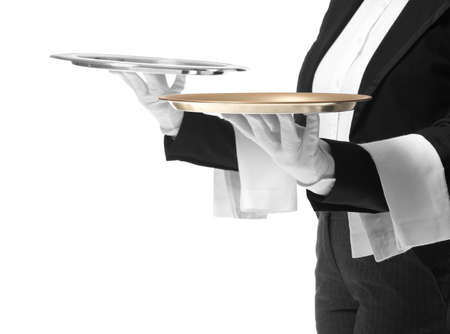 Male and female waiters with empty trays on white background Foto de archivo