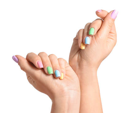 Hands of young woman with beautiful manicure on white background