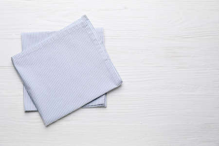 Clean napkins on wooden background