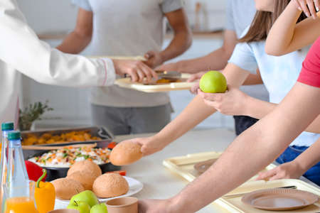 Pupils visiting school canteen to have lunch Standard-Bild