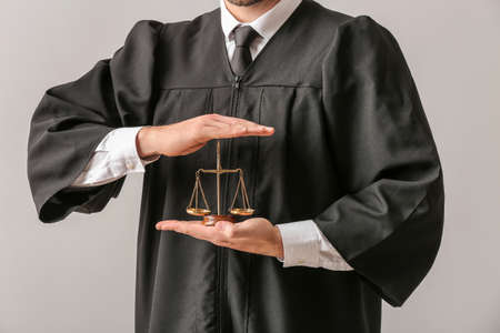 Male judge on light background, closeup