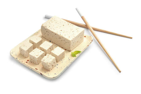 Plate with tasty tofu cheese on white background