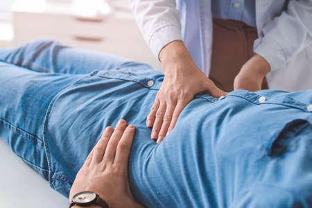 Gastroenterologist examining man in clinic Stock Photo