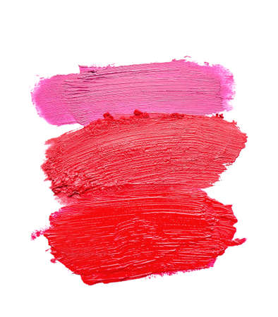 Strokes of bright lipsticks on white background