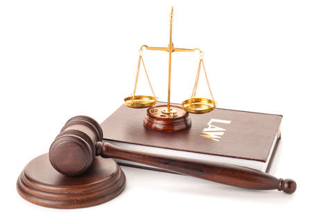Judge's gavel, book and scales of justice on white background