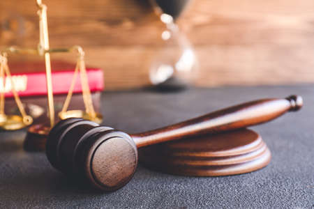 Judge's gavel on table in office