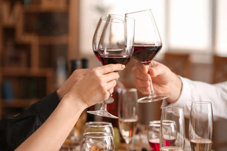 People tasting wine at the restaurant Stock Photo