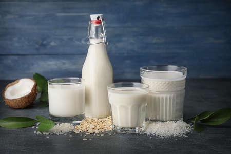 Different milk on dark table