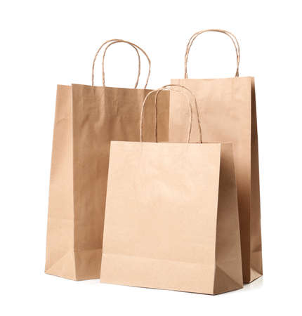 Paper shopping bags on white background Foto de archivo