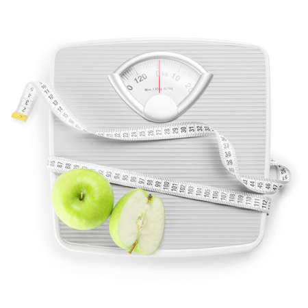 Weight scales with measuring tape and apples on white background. Slimming concept Banque d'images