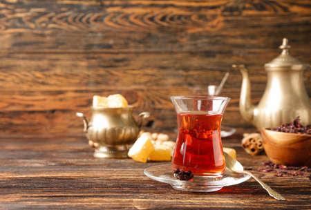 Glass of tasty Turkish tea on table