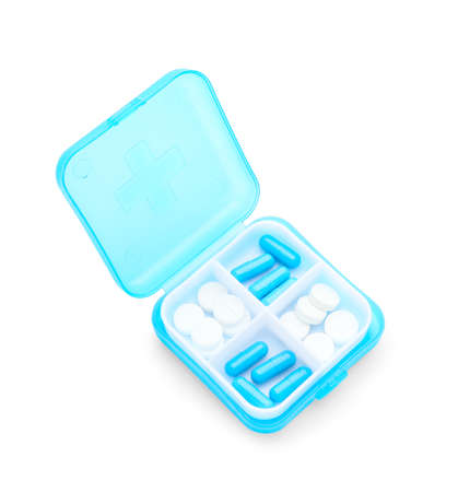 Container with pills on white background