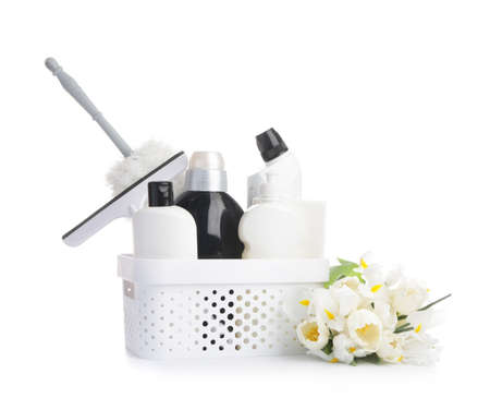 Set of cleaning supplies and spring flowers on white background Imagens