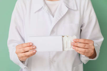 Doctor with hemorrhoidal suppositories, closeup