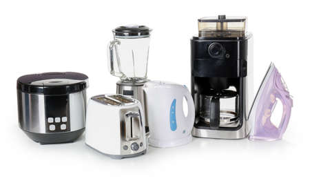 Different household appliances on white background