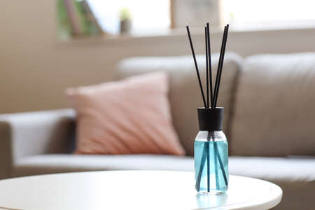 Reed diffuser on table in room