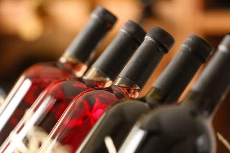 Bottles of wine in cellar, closeup Foto de archivo