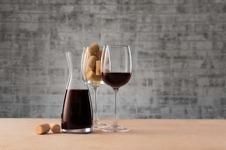 Decanter of wine and glasses on table Stock Photo