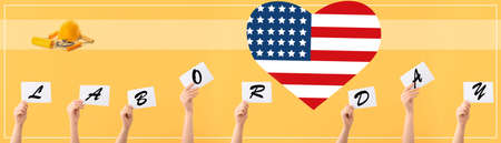 Many hands holding paper sheets with text LABOR DAY and heart in colors of USA flag on yellow background
