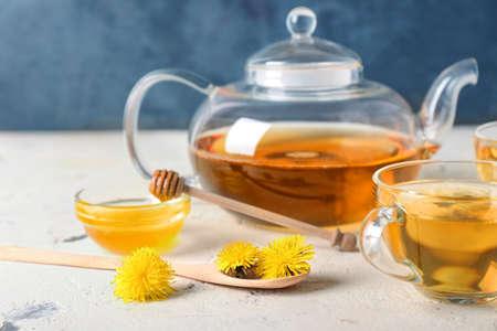 Healthy dandelion tea with honey on table Reklamní fotografie