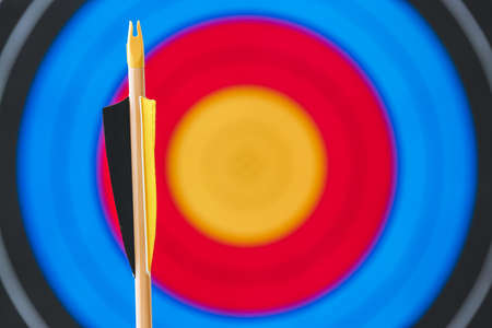 Arrow for archery against target on wall, closeup