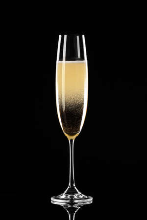 Glass of champagne on dark background