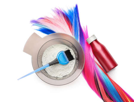 Supplies for hair coloring on white background