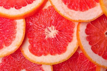 Fresh cut grapefruit as background