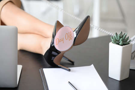 Businesswoman before weekends in office, closeup