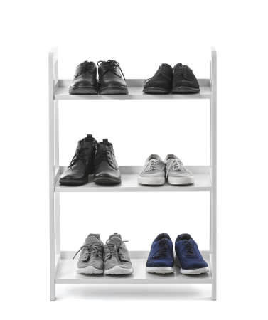 Stand with shoes on white background