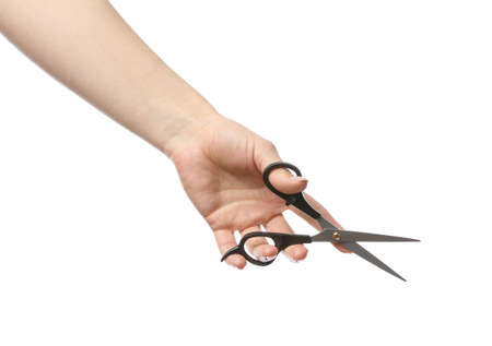 Female hand with hairdresser's scissors on white background