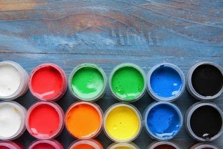 Bottles of gouache paints on table Standard-Bild