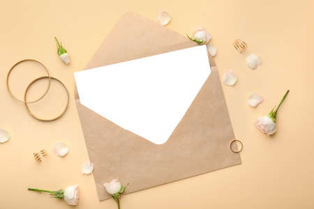 Composition with blank card and envelope on color background