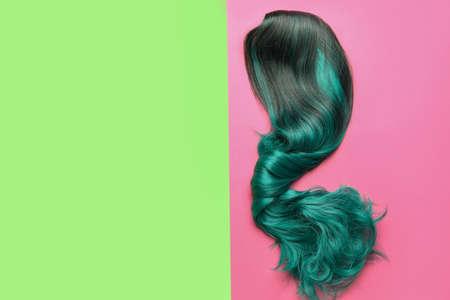 Unusual wig on color background Archivio Fotografico