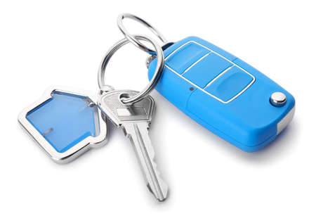 Keys from house and car on white background