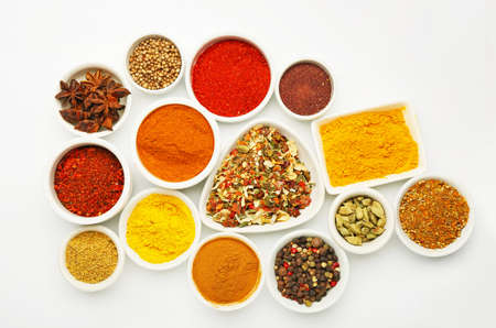 Bowls with different aromatic spices on white background Stock Photo