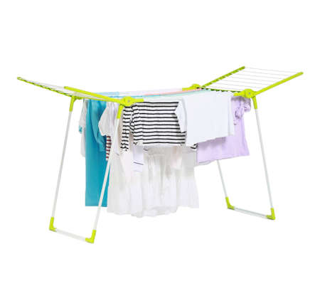 Clean clothes hanging on dryer against white background Stock fotó