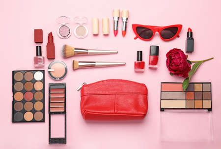 Set of decorative cosmetics and accessories on color background Фото со стока
