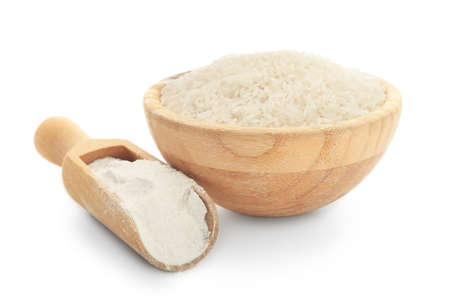 Bowl with rice and scoop with flour on white background