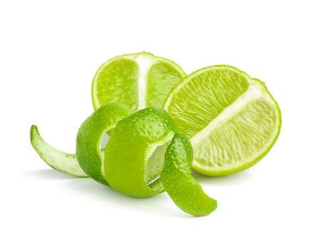 Ripe lime and peel on white background