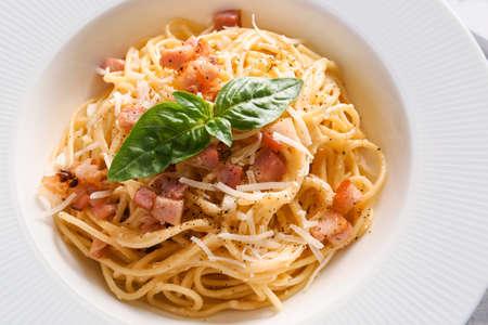 Plate with tasty pasta carbonara, closeup