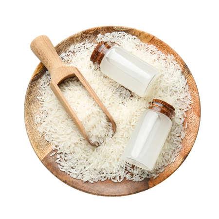 Bottles of rice water on white background Stockfoto