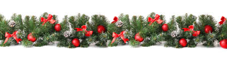Beautiful Christmas tree branches with decor on white background Foto de archivo