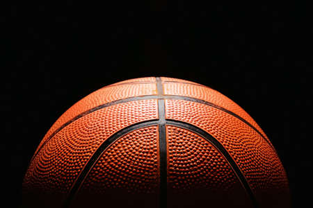 Ball for playing basketball on dark background, closeup