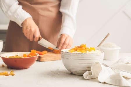 Woman preparing tasty rice in kitchen, closeup