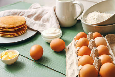 Ingredients for pancakes on table