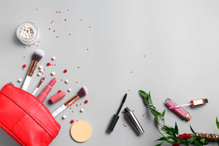 Set of decorative cosmetics and accessories on light background