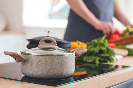 Cooking pot on stove in kitchen