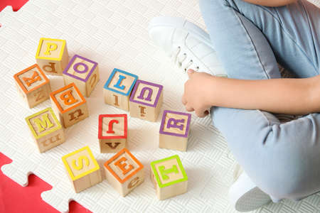 Little girl with autistic disorder playing with cubes Stock Photo