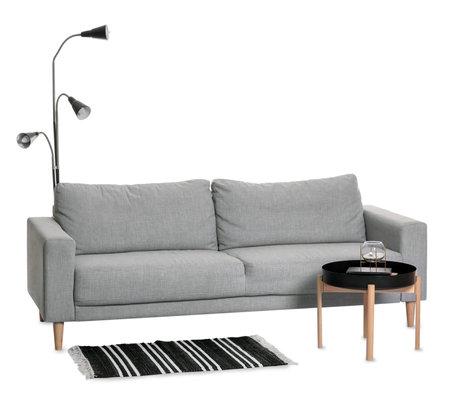Stylish sofa and table on white background